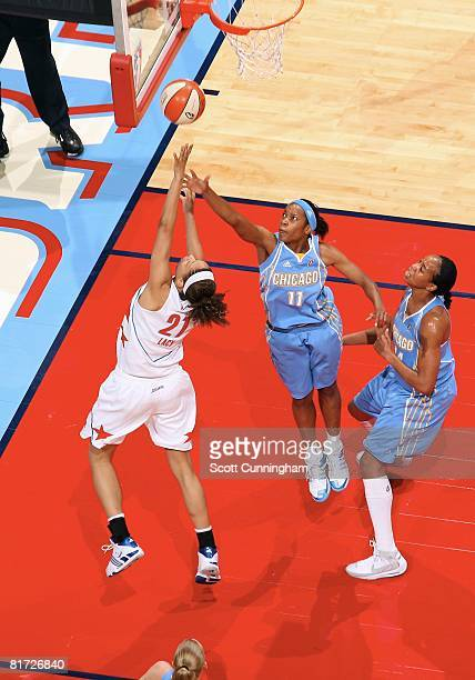 Jia Perkins of the Chicago Sky challenges the shot by Jennifer Lacy of the Atlanta Dream during the WNBA game on June 6 2008 at Philips Arena in...