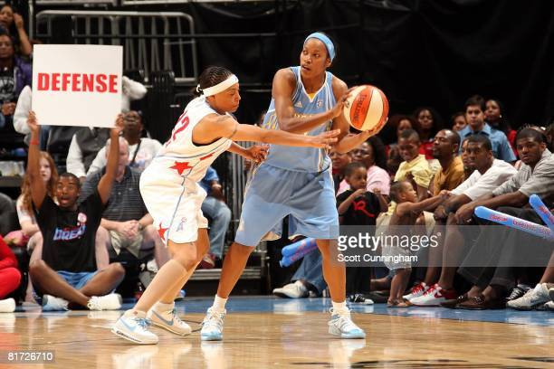 Jia Perkins of the Chicago Sky looks to pass under pressure against Betty Lennox of the Atlanta Dream during the WNBA game on June 6 2008 at Philips...