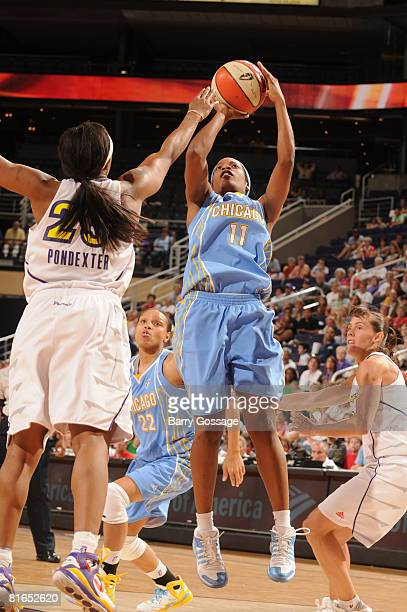 Jia Perkins of the Chicago Sky shoots against Cappie Pondexter of the Phoenix Mercury on June 20 at U.S. Airways Center in Phoenix, Arizona. NOTE TO...