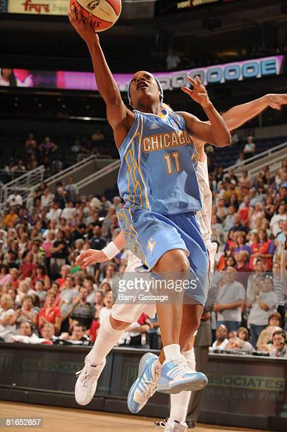 Jia Perkins of the Chicago Sky shoots against Diana Taurasi of the Phoenix Mercury on June 20 at U.S. Airways Center in Phoenix, Arizona. NOTE TO...