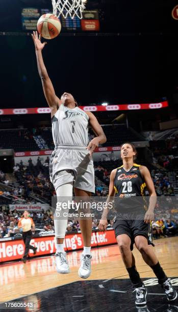 Jia Perkins of the San Antonio Silver Stars shoots against Nicole Powell of the Tulsa Shock at the ATT Center on August 4 2013 in San Antonio Texas...