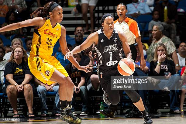 Jia Perkins of the San Antonio Stars handles the ball against Glory Johnson of the Tulsa Shock during the WNBA game on August 8 2014 at the BOK...