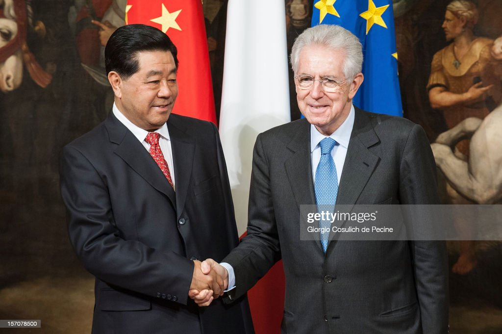 Jia Qinglin (L), Chairman of the National Committee of the Chinese People's Political Consultative Conference, shakes hand with Italian Prime Minister Mario Monti prior a meeting at Palazzo Chigi on November 28, 2012 in Rome, Italy. Jia Qinglin is on a three country tour that also includes Costa Rica and Argentina.