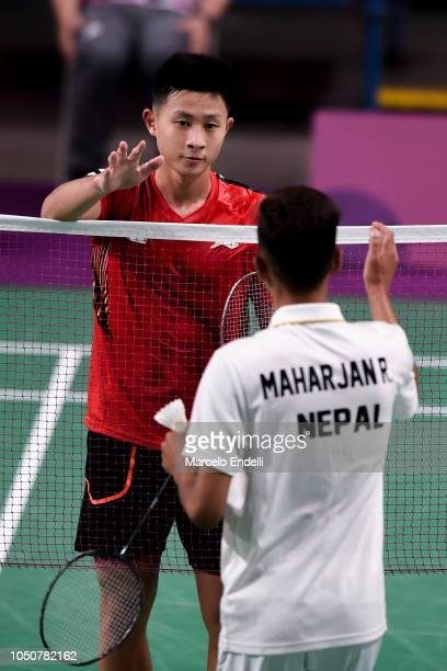 Jia Wei Joel Koh of Singapore greets Rukesh Maharjan of Nepal after winning the men's singles match 2on day 1 of the Buenos Aires Youth Olympics at...