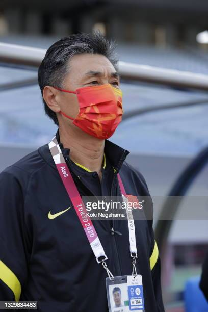 Jia Xiuquan, Head Coach of Team China wears a face mask prior to the Women's First Round Group F match between China and Brazil during the Tokyo 2020...