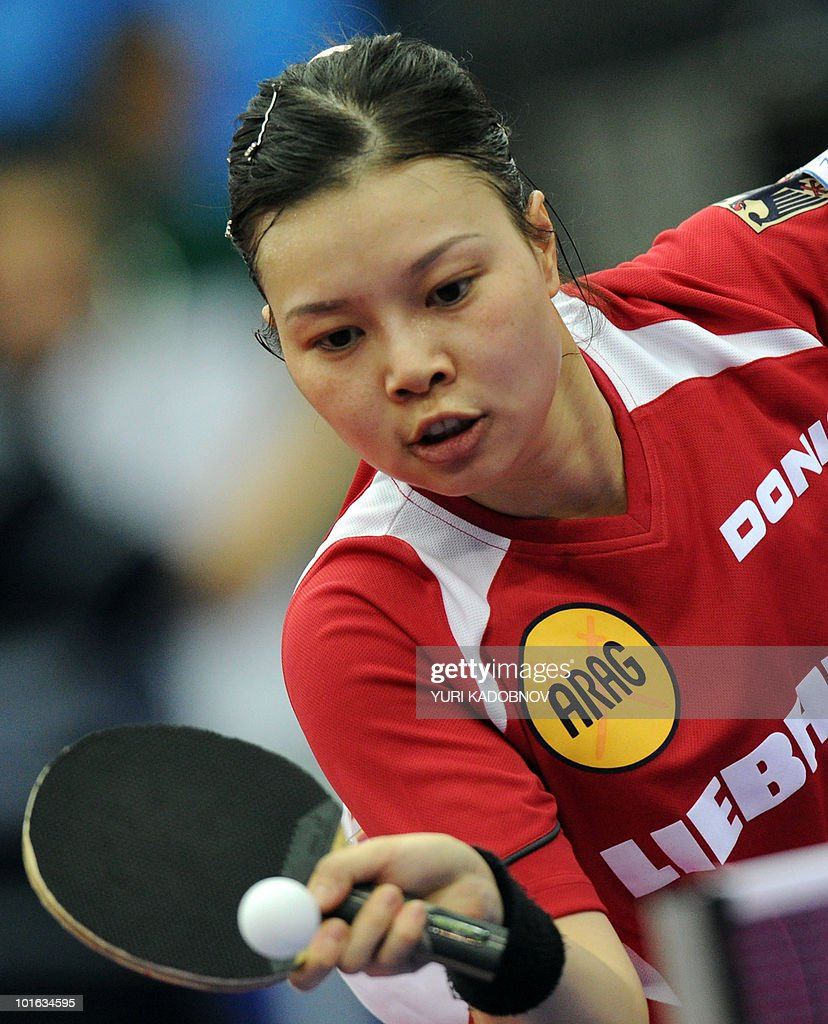 Jiaduo Wu of Germany returns a service to Tianwei Feng of Singapore during the women's semi final at the 2010 World Team Table Tennis Championships in Moscow on May 29, 2010.
