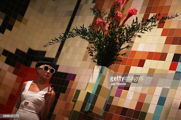 JiaJia Fei checks out the Tobias Rehberger art installation on display during the opening day of Art Basel on December 2 2015 in Miami Beach Florida...