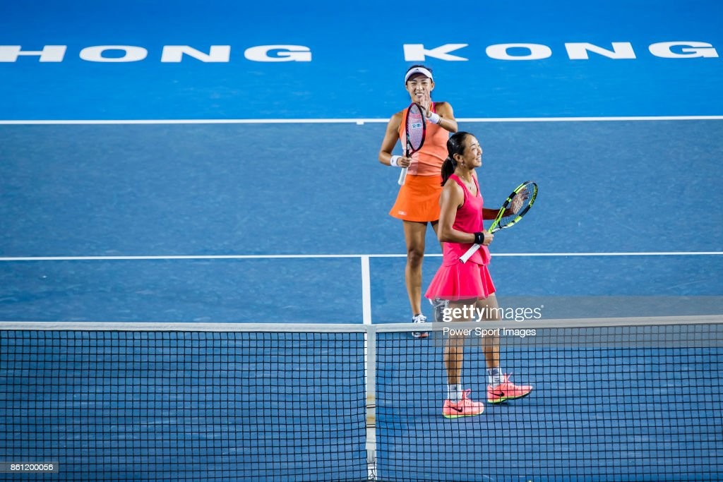 Jia-Jing Lu (bottom) of China and Qiang Wang (top) of China celebrate winning the women's doubles semi-final match against Monique Adamczak of Australia and Kai-Chen Chang of Taiwan at the Prudential Hong Kong Tennis Open 2017 at Victoria Park on October 14, 2017 in Hong Kong, Hong Kong.