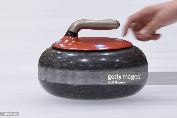 Jialiang Zang of China places a stone during the preliminary round of the men's curling against Kazakhstan on the day one of the 2017 Sapporo Asian...