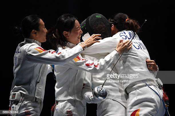 Jialu Hao Yiwen Sun Anqi Xu and Yujie Sun of China celebrate after defeating Estonia in a Women's Epee Team Semifinal bout on Day 6 of the 2016 Rio...