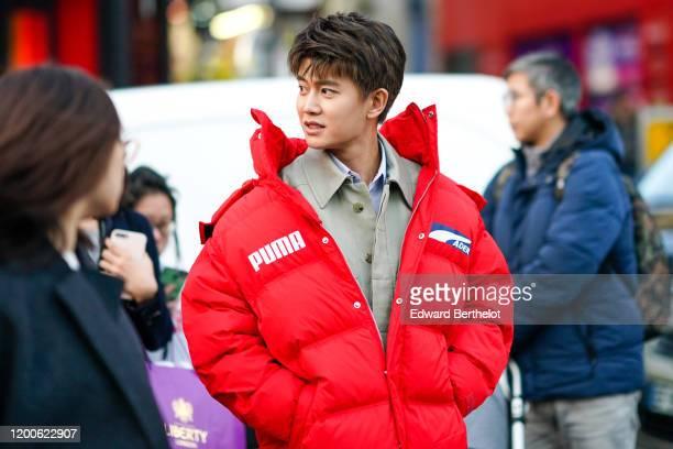 Jialun Ren wears a sand-color shirt, a red Puma puff jacket, outside Paul Smith, during Paris Fashion Week - Menswear Fall/Winter 2020-2021 on...