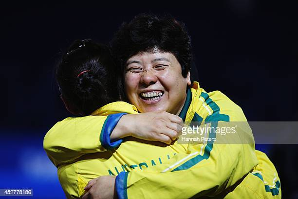 Jian Fang Lay of Australia celebrates winning the bronze medal in the Women's Team match against India at Scotstoun Sports Campus during day four of...
