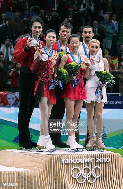 Jian Tong and Qing Pang of China win the silver medal Hongbo Zhao and Xue Shen of China win the gold medal and Robin Szolkowy and Aliona Savchenko of...