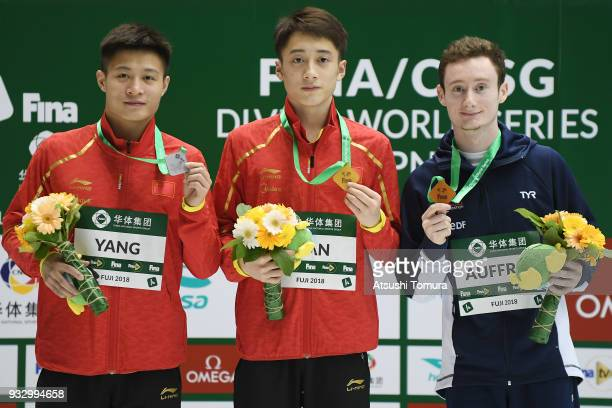 Jian Yang of China Junjie Lian of China and Benjamin Auffret of France pose on the podium after the Men's 10m Platform final during day three of the...