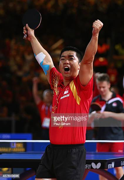 Jian Zhan of Singapore celebrates winning match point against Andrew Baggaley of England to win the Gold Medal for Singapore in the Men's Team Table...