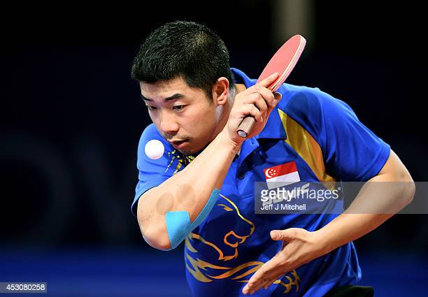 Jian Zhan of Singapore competes against Ning Gao of Singapore in the Men's Singles Gold Medal Match at Scotstoun Sports Campus during day ten of the...