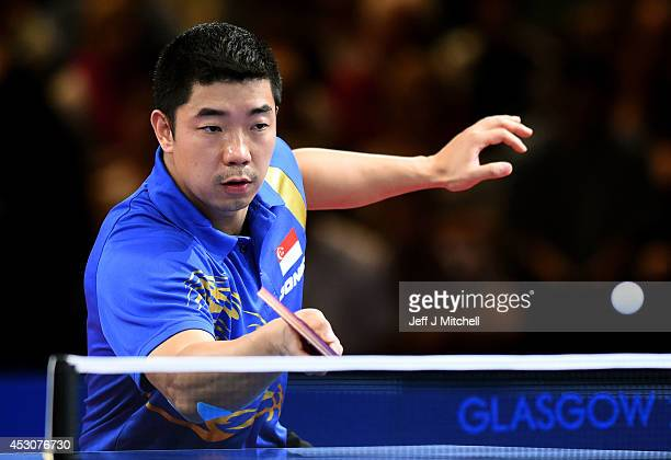 Jian Zhang of Singapore competes against Ning Gao of Singapore in the Men's Singles Gold Medal Match at Scotstoun Sports Campus during day ten of the...