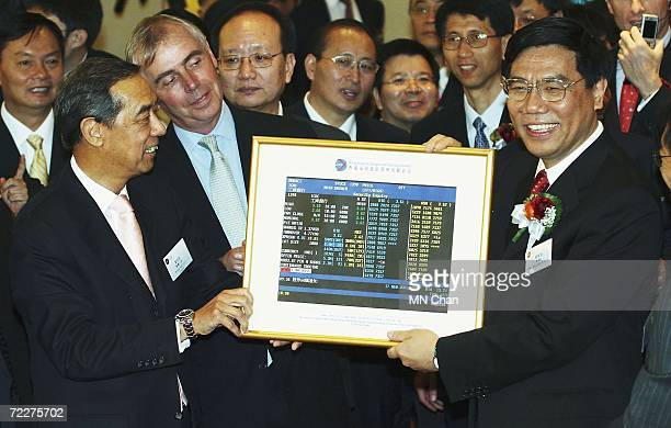 Jiang Jianqing chairman and president of the Industrial and Commercial Bank of China and Ronald Arculli chairman of Hong Kong Exchange hold a photo...