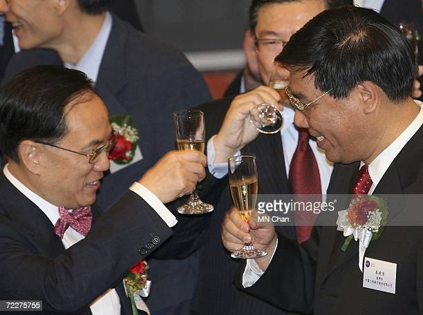 Jiang Jianqing chairman and president of the Industrial and Commercial Bank of China and Donald Tsang Hong Kong Chief Executive toast during the...