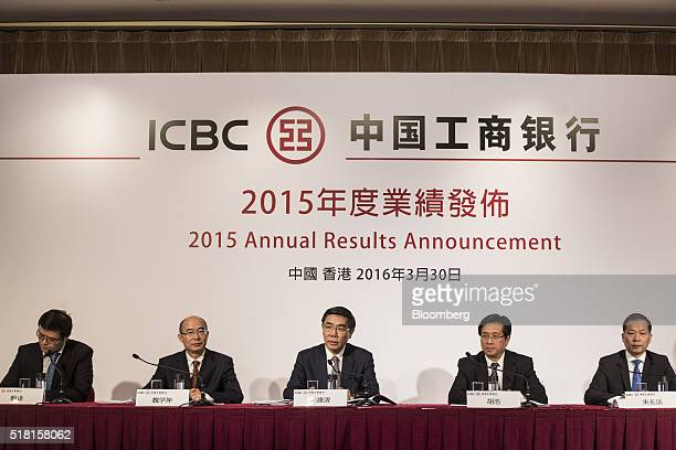 Jiang Jianqing chairman of Industrial Commercial Bank Of China Ltd center speaks as during a news conference in Hong Kong China on Wednesday March 30...