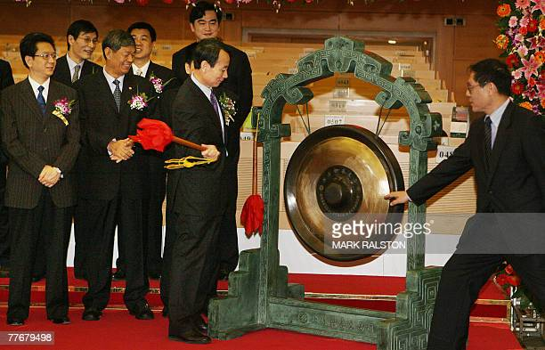 Jiang Jiemin chairman of PetroChina beats the gong to begin trading on their shares during their IPO at the Shanghai Stock Exchange 05 November 2007...