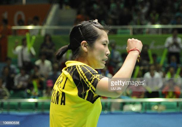 Jiang Yanjiao of China celebrates her victory against Taerattanachai S.of Thailand during their badminton women's team finals at the 16th Asian Games...