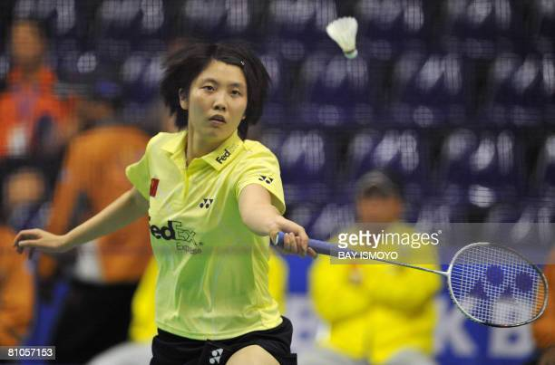 Jiang Yanjiao of China returns a shot against Carola Bott of Germany during their Thomas Cup badminton match in Jakarta on May 12, 2008. Jiang won...