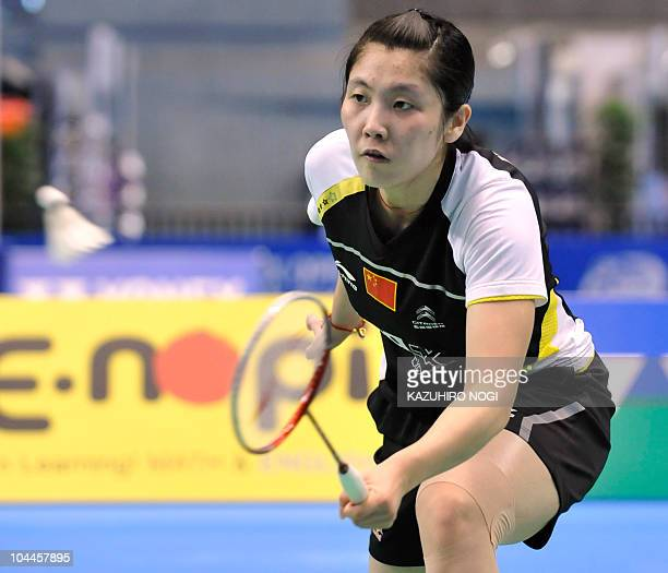 Jiang Yanjiao of China returns a shot against her Chinese fellow Wang Xin during the women's singles final match at the Japan Open badminton...