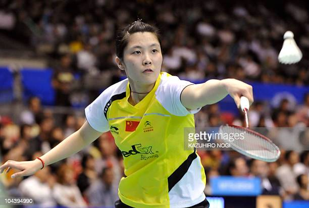 Jiang Yanjiao of China returns a shot against her compatriot Lu Lan during the women's singles quarter-final match at the Japan Open badminton...