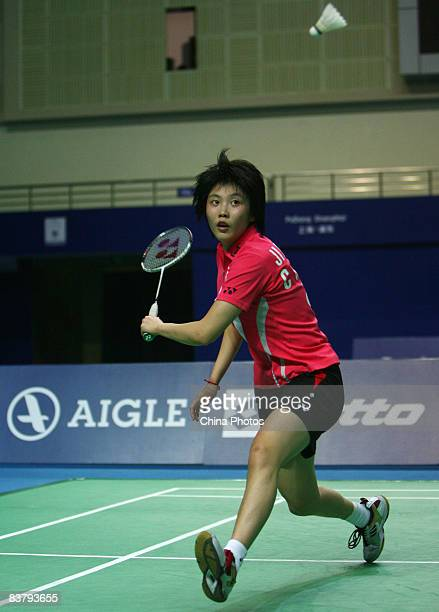 Jiang Yanjiao of China returns a shot against her compatriot Zhu Jingjing in the women's singles finals badminton match during the 2008 Li-Ning China...