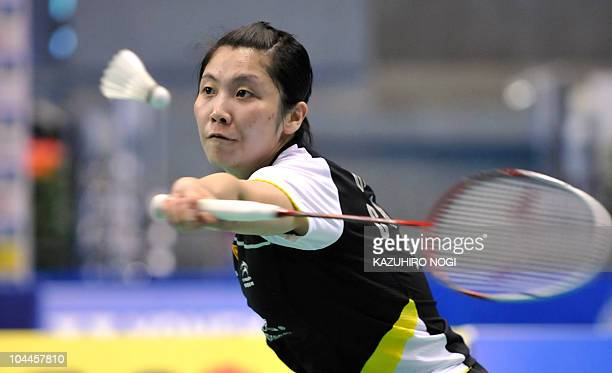 Jiang Yanjiao of China returns the shuttlecock to her Chinese fellow Wang Xin during the women's singles final match at the Japan Open badminton...