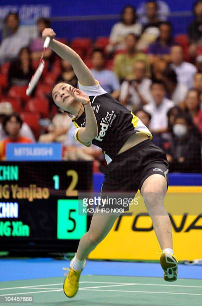 Jiang Yanjiao of China smashes a shot against her Chinese fellow Wang Xin during the women's singles final match at the Japan Open badminton...