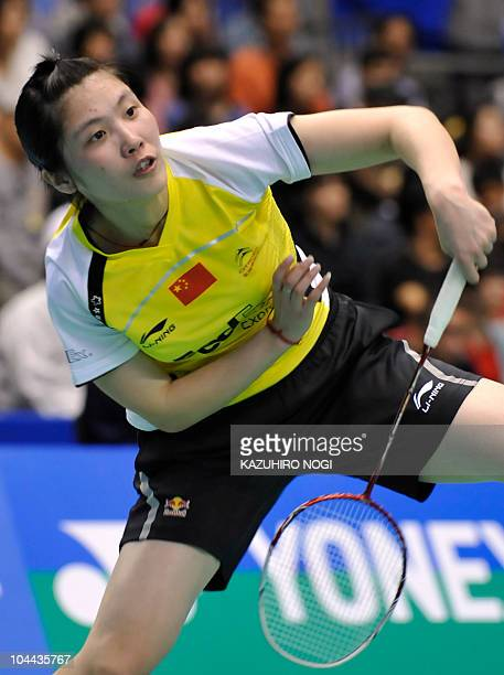 Jiang Yanjiao of China smashes a shot against her compatriot Wang Shixian during the semi-final match at the Japan Open badminton tournament in Tokyo...