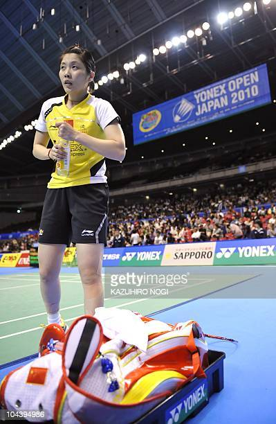 Jiang Yanjiao of China takes a rest during the women's singles quarter-final match against her compatriot Lu Lan at the Japan Open badminton...