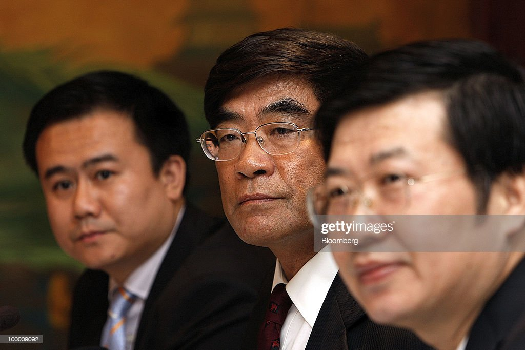 Jiang Yongzhi, joint secretary of Cnooc Ltd., left, Fu Chengyu, chairman of Cnooc Ltd., center, and Wu Guangqi, chief compliance officer of Cnooc Ltd., attend a news briefing following the company's annual general meeting in Hong Kong, China, on Thursday, May 20, 2010. Fu declined to say whether the company had bid for a Brazilian asset owned by Statoil ASA. Fu told reporters in Hong Kong he does not wish to comment on 'market rumors.' Photographer: Daniel J. Groshong/Bloomberg via Getty Images