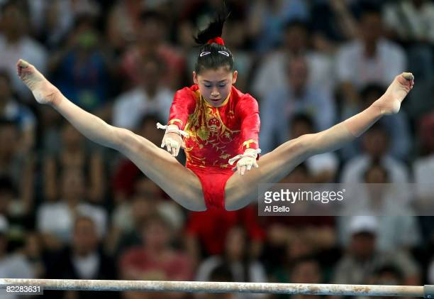 Jiang Yuyuan of China competes in the uneven bars during the artistic gymnastics team event at the National Indoor Stadium during Day 5 of the...