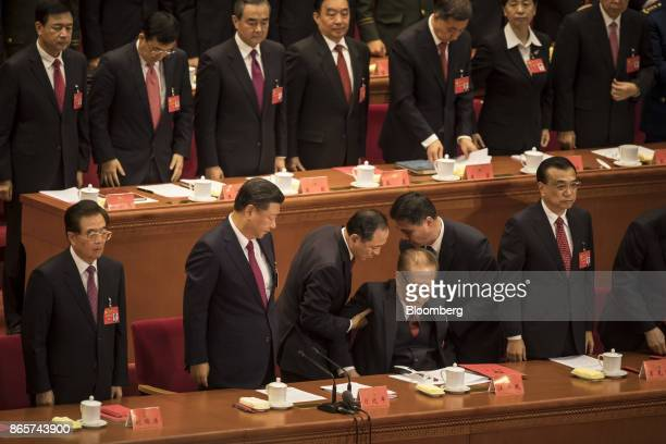 Jiang Zemin China's former president third right is assisted by two attendants as Xi Jinping China's president second left Hu Jintao China's former...