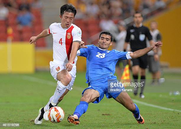 Jiang Zhipeng of China is challenged by Akmal Shorakhmedov of Uzbekistan during the 2015 Asian Cup match between China PR and Uzbekistan at Suncorp...