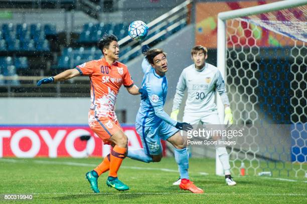 Jiangsu FC Defender Hong Jeongho fights for the ball with Jeju United FC Midfielder Lee Chandong during the AFC Champions League 2017 Group H match...