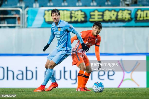 Jiangsu FC Defender Hong Jeongho in action against Jeju United FC Forward Hwang Ilsu during the AFC Champions League 2017 Group H match between Jeju...