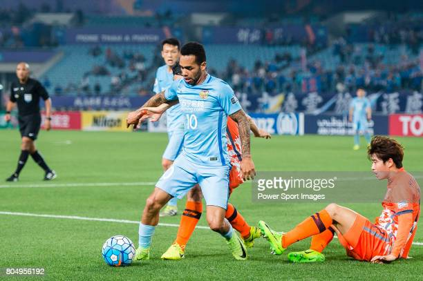 Jiangsu FC Forward Alex Teixeira in action against Jeju United FC Midfielder Kwon Soonhyung during the AFC Champions League 2017 Group H match...