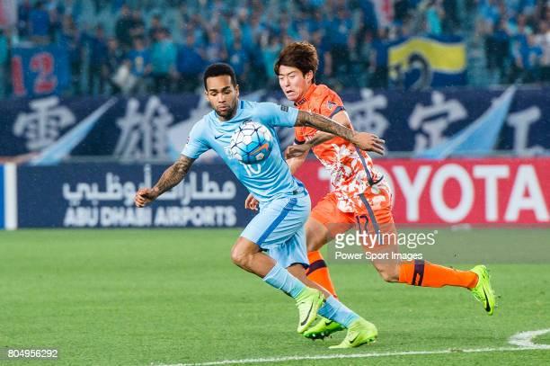 Jiangsu FC Forward Alex Teixeira in action against Jeju United FC Forward Ahn Hyunbeom during the AFC Champions League 2017 Group H match between...