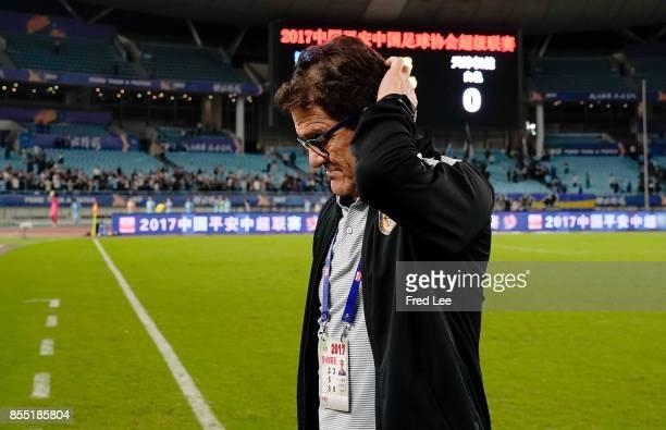 Jiangsu FC head Coach Fabio Capello looks on dejected after the China Super League match between Jiangsu FC and Tianjin Quanjian FC at Nanjing...
