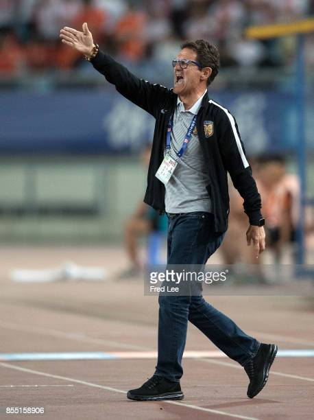 Jiangsu FC head Coach Fabio Capello shouts instructions to his players during the China Super League match between Jiangsu FC and Tianjin Quanjian FC...