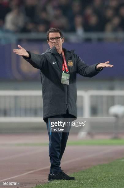 Jiangsu FC head Coach Fabio Capello shouts instructions to his players during the 2018 Chinese Super League match between Jiangsu Suning and Beijing...