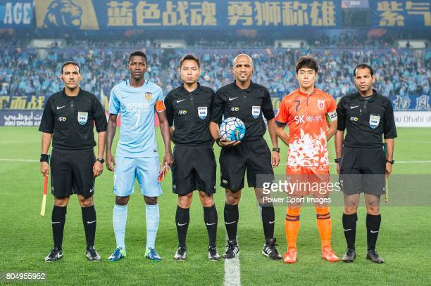 Jiangsu FC Midfielder Ramires Santos Jeju United FC Midfielder Kwon Soonhyung with Fifa Referees Hamed Sulaiman Al Mayahi Sivakorn PuUdom Ahmed Abu...
