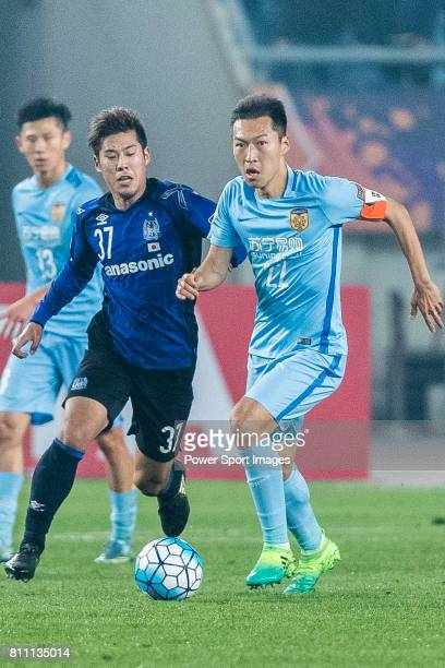 Jiangsu FC Midfielder Wu Xi fights for the ball with Gamba Osaka Forward Takagi Akito during the AFC Champions League 2017 Group H match between...