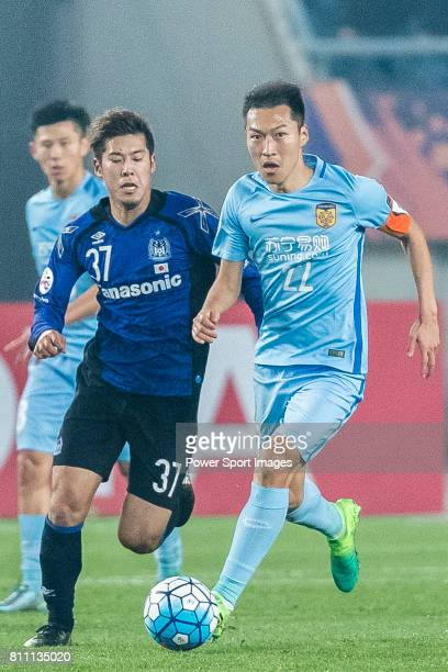 Jiangsu FC Midfielder Wu Xi fights for the ball with Gamba Osaka Forward Takagi Akito during the AFC Champions League 2017 Group H match between...