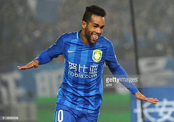 Jiangsu Suning's Alex Teixeira celebrates during the Chinese Super League football between Jiangsu Suning and Shandong Luneng on March 5 2016 in...
