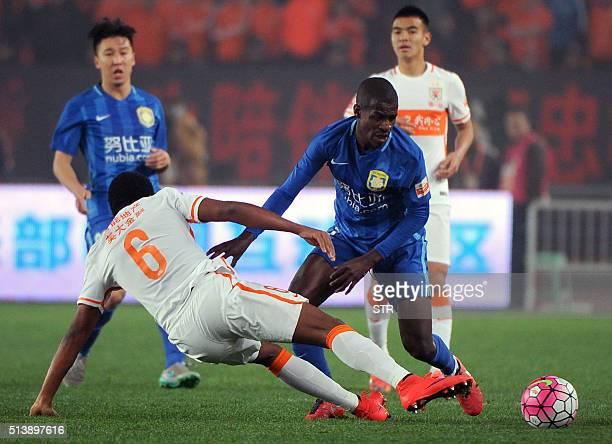 Jiangsu Suning's Ramires vies for the ball during the Chinese Super League football match between Jiangsu Suning and Shandong Luneng on March 5 2016...